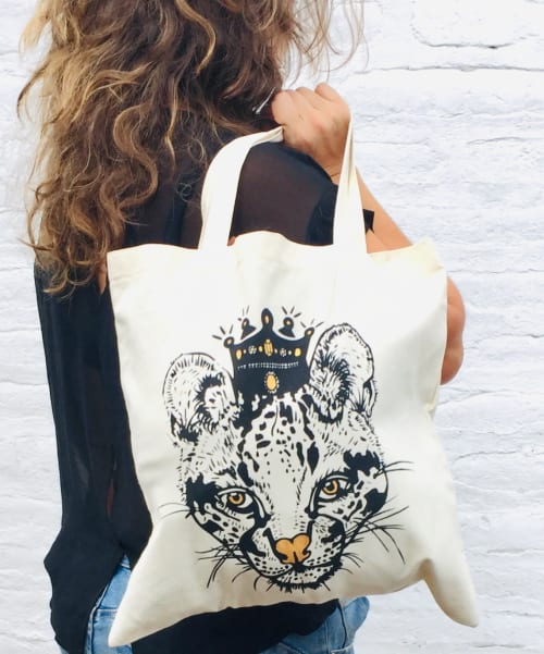 Apparel & Accessories by Pamela Goldhagen seen at Private Residence, Quito - Tote Bag- Ocelot Queen and Capuchin Monkey King
