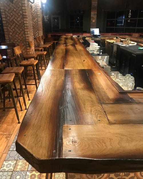 Tables by JM Lifestyles seen at Rocco's Tacos & Tequila Bar, Fort Lauderdale - WoodForm Concrete Countertop