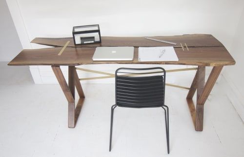 Tables by Wolf Wood Co seen at Digital Kitchen, Chicago - Walnut + Brass Bar Inlay Front Desk