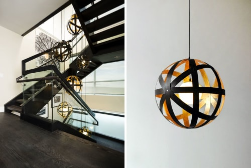Pendants by Propellor Studio seen at Vancouver, Vancouver - Meridian 24 - Black stained walnut with gold leafed interior