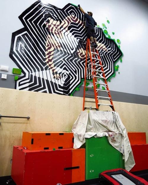 Murals by Bill Tavis seen at Tumble Tech, Cedar Park - Parkour Jumper