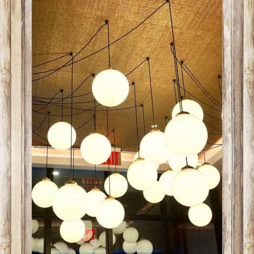Pendants by Luke Lamp Co. seen at Four Points by Sheraton Manhattan Midtown West, New York - Globe Lights