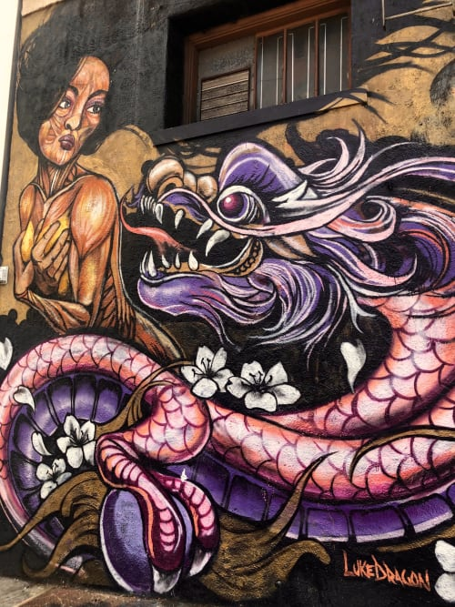 Street Murals by LUQMAN seen at 564 Grant Ave, San Francisco - Girl and Dragon Mural