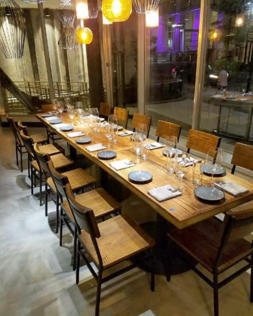 Tables by Rustic River Creations seen at Deacon's New South, Nashville - Custom Restaurant Tables