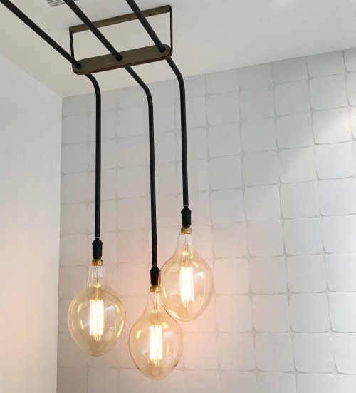 Sconces by Buzzell Studios seen at Private Residence, Los Angeles - Single Bend Pipe 3 Bulb Sconce