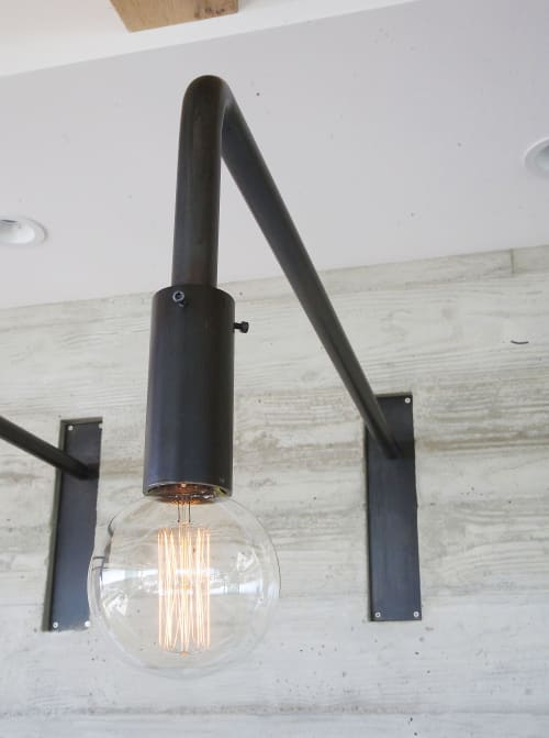 Sconces by Buzzell Studios seen at Private Residence, Newport Beach - Pipe Wall Sconce AD with Table