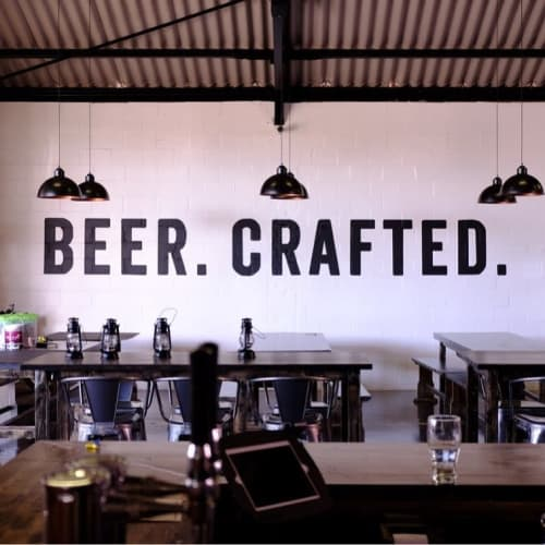 Murals by Cape Town Signwriting seen at Jack Black Brewing Company, Cape Town - Typographical Mural