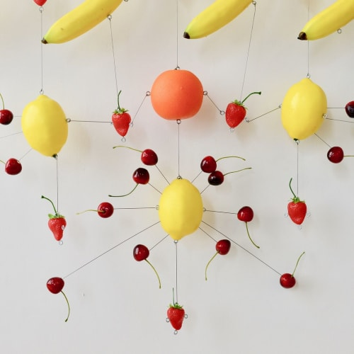 Wall Hangings by Joseph Algieri seen at Fredericks and Mae, Brooklyn - Mobile, faux fruit and piano wire