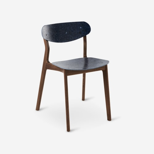 Chairs by Planq seen at PVH Europe, Amsterdam - UBU chair - A chair in solid walnut wood and recycled jeans