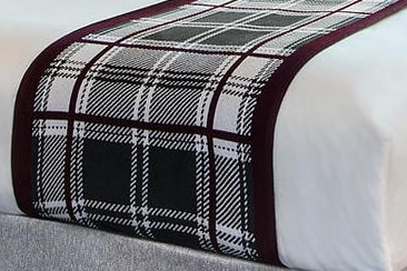 Linens & Bedding by Studio Twist seen at Texas A&M Hotel and Conference Center, College Station - Knitted Throws in Polypropylene & Polyplush - Custom Plaid and Houndstooth