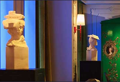 Sculptures by Kathy Dalwood seen at Kimpton Hotel Monaco Pittsburgh, Pittsburgh - Tank Girl and Bookworm