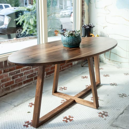Tables by Art Builders Guild seen at Amethyst Coffee- Lakeside, Denver - Walnut Community Table