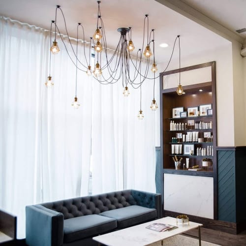 Chandeliers by Hangout Lighting seen at Base Salon, Chicago - Swag Chandeliers with Brass Hinge Cages