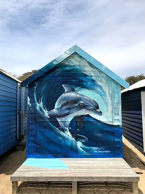 Murals by Damien Arena seen at Brighton Bathing Boxes, Brighton - Dolphin Surfer