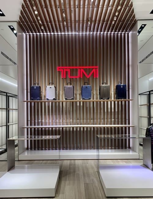 Architecture by Do The Magic seen at TUMI Store - 610 Madison, New York - Maintenance touch up work on existing fixtures.