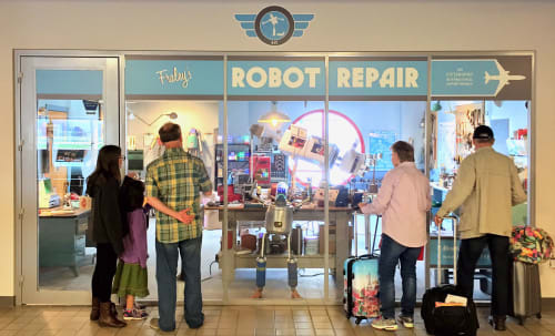 Public Sculptures by Toby Atticus Fraley seen at Pgh International airport lower level, Moon - Fraley's Robot Repair at The Pittsburgh International Airport