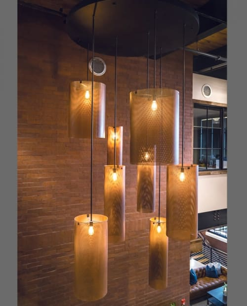 Pendants by ILEX Architectural Lighting seen at Betenbough Homes - Home Office, Lubbock - Custom Perforated Metal Pendants