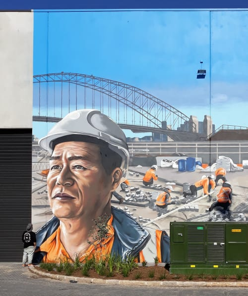 Murals by Reubszz seen at Greenacre, Greenacre - Sam the Paving Man