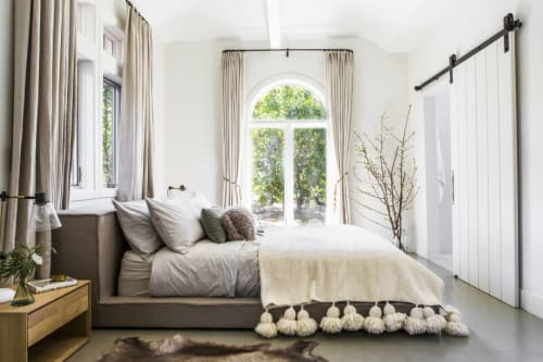 Linens & Bedding by l'aviva home seen at Private Residence, Los Angeles - Moroccan Pom Pom Blankets