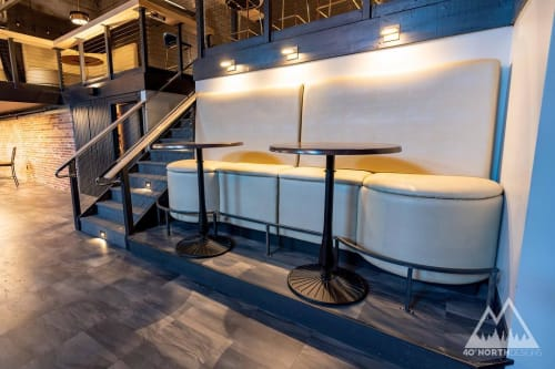 Furniture by 40 North Designs seen at Buffalo Rose, Golden - Custom Designed Booths and Foot Railings