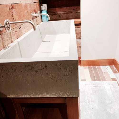 Water Fixtures by Woven 3 Design seen at Private Residence, Whitefish - Concrete trough sink