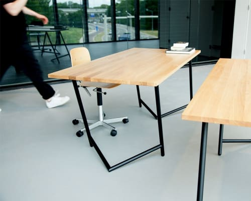 Tables by Rahmlow seen at Muziekgieterij, Maastricht - Varius trestles by Rahmlow