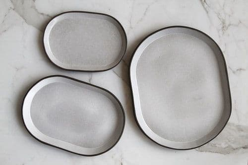 Tableware by Jono Pandolfi seen at Momofuku Nishi, New York - Coupe Crudo Bowl and Oval Platter