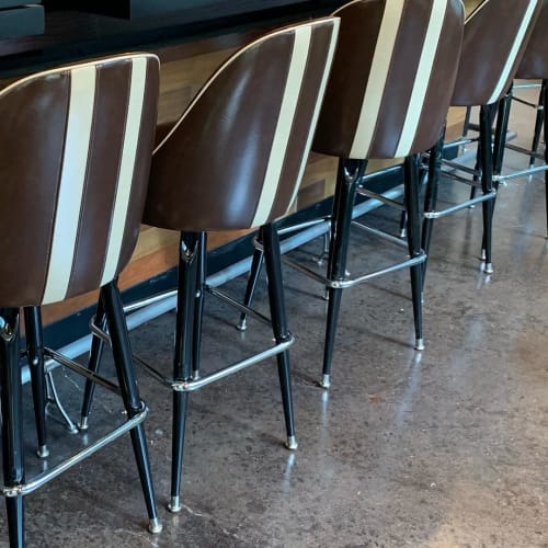 Chairs by Richardson Seating Corporation seen at Wahlburgers, Chicago - Striped Bar Stools