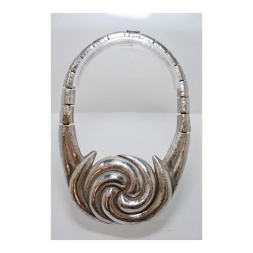 Apparel & Accessories by Graziella Laffi seen at Private Residence, San Diego - Large, Silver Necklace w/ circles & matching cuff w/ circles