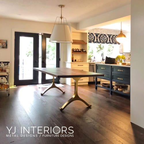 Tables by YJ Interiors seen at Private Residence, Toronto - Custom black walnut dining table with brass wishbone legs