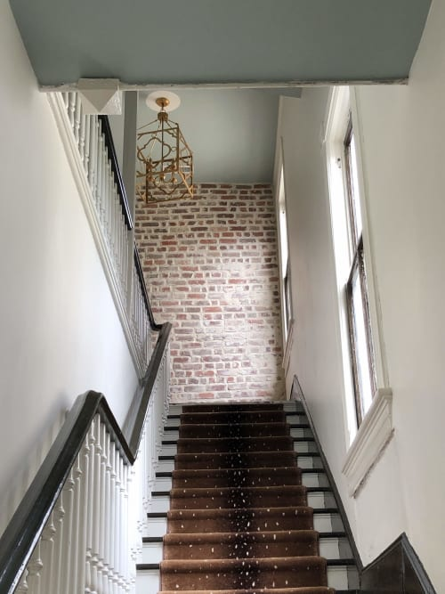 Wall Treatments by EMILY POPE HARRIS ART seen at The Inns Charleston, Charleston - Brick Accent Wall