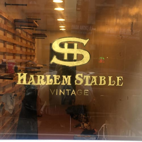 Signage by Ancient Art seen at Harlem stable, New York - Harlem Stable Sign