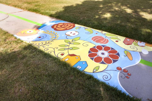 "Street Murals by Yulia Avgustinovich seen at Mountair Park, Lakewood - Ground mural ""Blooming city"""
