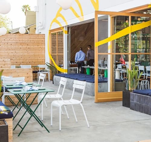 Chairs by Fermob USA at Superba Food + Bread, Los Angeles - The Luxembourg Stacking Side Chair