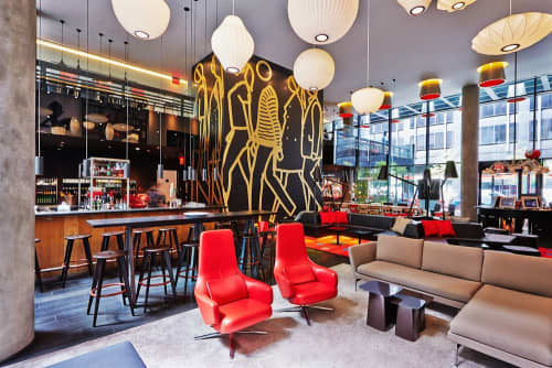 Chairs by Antonio Citterio seen at citizenM New York, New York - Red Repos Chair