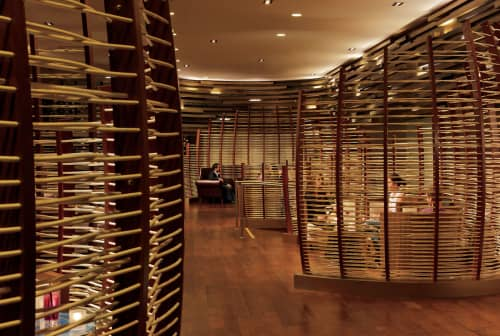 Chairs by ICRAVE seen at WP24 by Wolfgang Puck, Los Angeles - Custom Woven Rattan Seating Pods