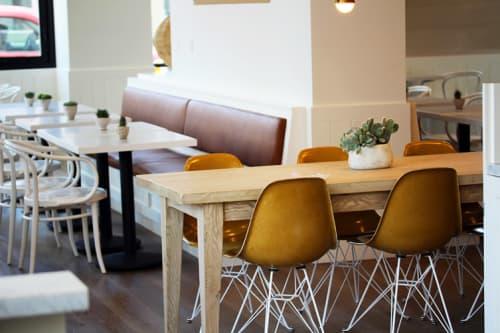 Chairs by Modernica seen at Café Gratitude (Arts District), Los Angeles - Fiberglass Shell Eiffel Chair