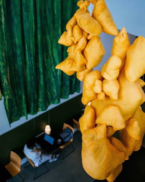 Sculptures by Lily Erb seen at Mudhouse Coffee 10th Street, Charlottesville - Mustard-colored soft sculpture