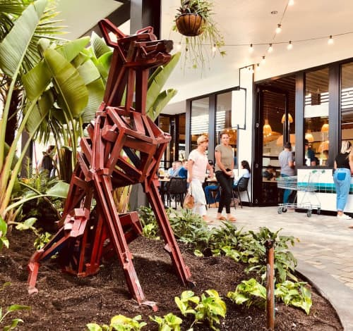 Public Sculptures by Cezary Stulgis seen at Westfield Coomera, Coomera - Sitting Dingo