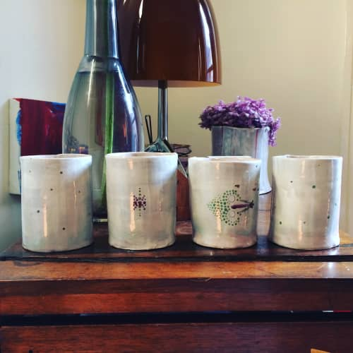 Cups by Mirja Hartwig seen at Private Residence, London - cups without handles, off white glazing with ornamental decoration