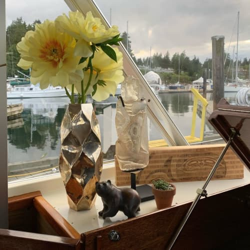 Sculptures by Cathryn Jenkins seen at Salt Spring Island Air Ltd, Vancouver - Bear Sculpture