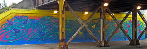Interrelation, mural | Street Murals by Jose Agustin Andreu | Pratt Ave. and Ravenswood Ave. underpass, Rogers Park, Chicago in Chicago