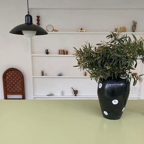 Tableware by Jordan McDonald Ceramics seen at 4175 24th St, San Francisco - Black Vase with Blossom Design