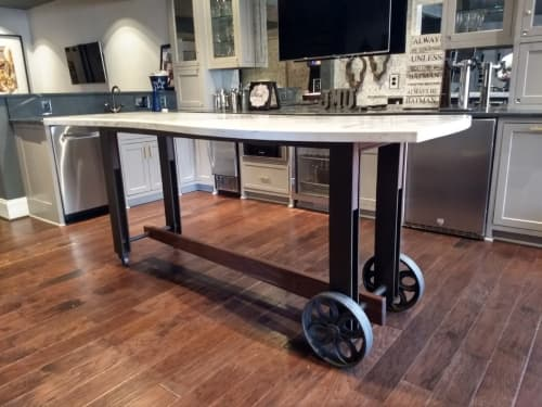 Tables by Alicia Dietz Studios seen at Private Residence, Midlothian - Rolling Concrete & Steel Bar Table