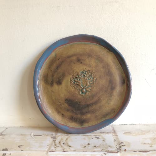 Ceramic Plates by Mirja Hartwig seen at Private Residence, London - tiger stamp plate