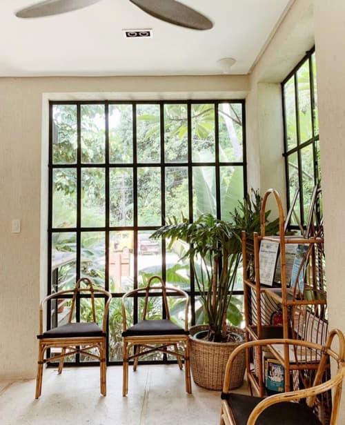 Chairs by E. Murio seen at Frangipani El Nido, El Nido - Rattan Chairs