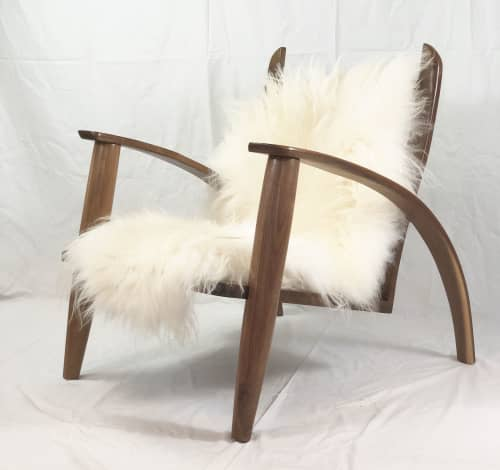 Brass back lounge chair | Chairs by Mako Woods
