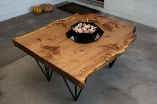 Tables by Lumberlust Designs seen at Private Home in New Hampshire - Alligator Juniper Live Edge Fire Pit Interactive Patio/Coffee Table