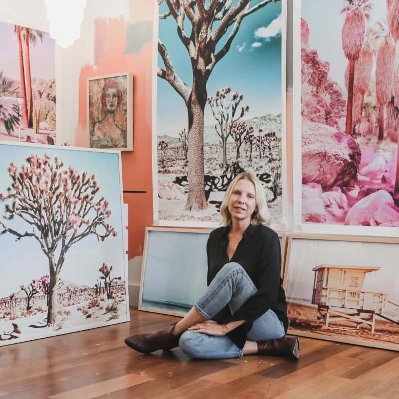 Kristin Hart in Front of Photographs of Joshua Trees and Desert Palms with Pastel Overtones