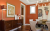 Paintings by Melanie Grein seen at Private Residence, Denver - Ejay Interiors, Orange Painting